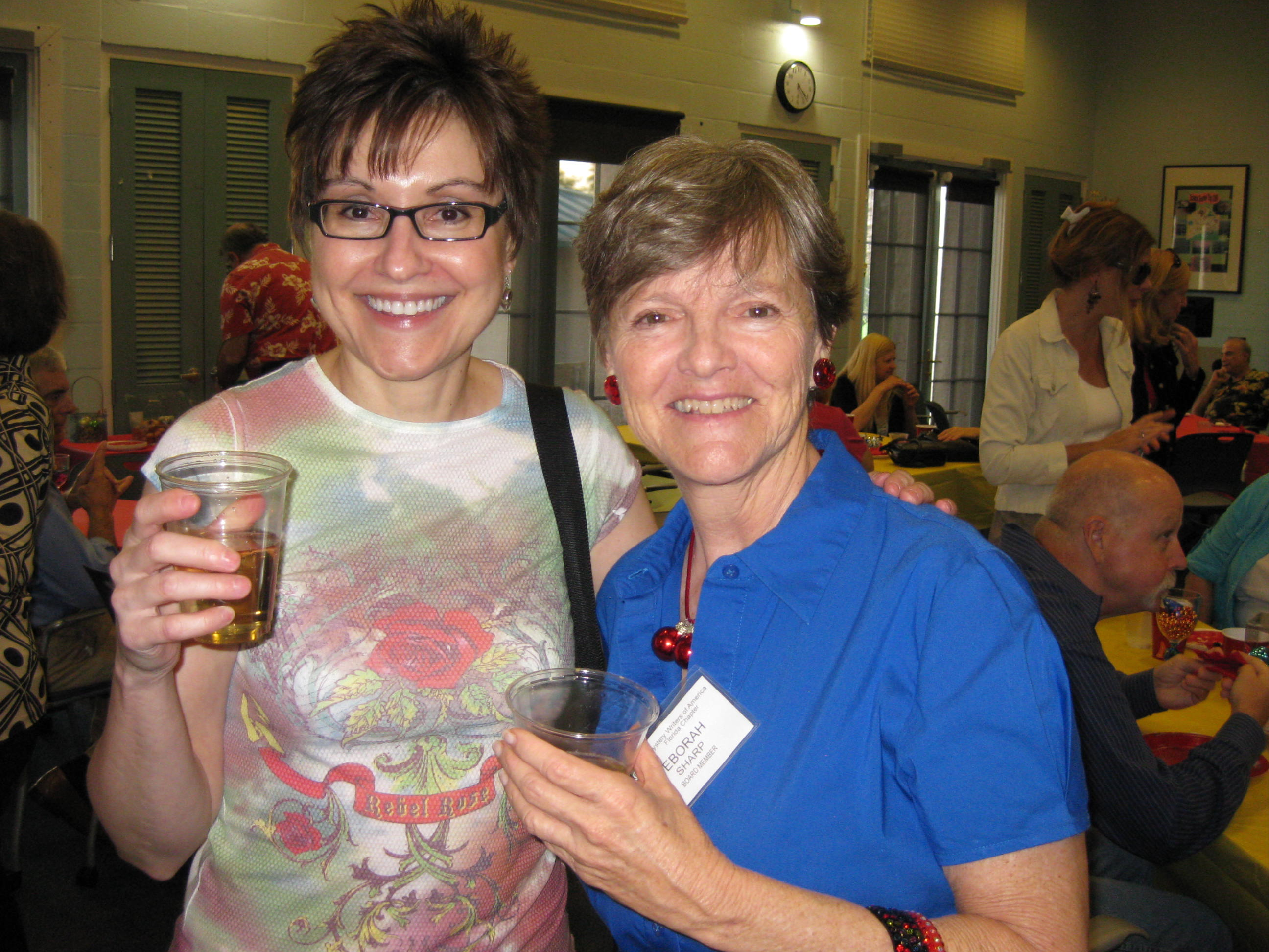 Mitzi Szereto with author Deborah Sharp in South Florida